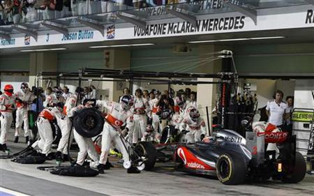McLaren Formula One driver Jenson Button of Britain performs a pit stop during the Abu Dhabi F1 Grand Prix at the Yas Marina circuit on Yas Island November 4, 2012. REUTERS/Suhaib Salem