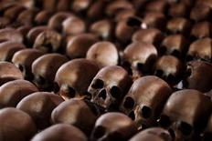 The skulls of Rwandan victims rest on shelves at a genocide memorial inside the church at Ntarama just outside the capital Kigali, August 6, 2010. REUTERS/Finbarr O'Reilly