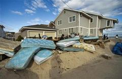 Ruined mattresses sit in a pile outside a beachfront home as residents continue to clean up after Hurricane Sandy in Point Pleasant Beach, New Jersey, November 4, 2012. REUTERS/Steve Nesius