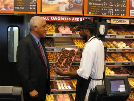 Safer Foundation Vice President of Community Corrections Jerry Butler talks with Dunkin' Donuts employee and former Safer Foundation client Norman Jessup in Chicago, Illinois, this undated handout photo. REUTERS/Jon Kaplan/Courtesy of the Safer Foundation/Handout