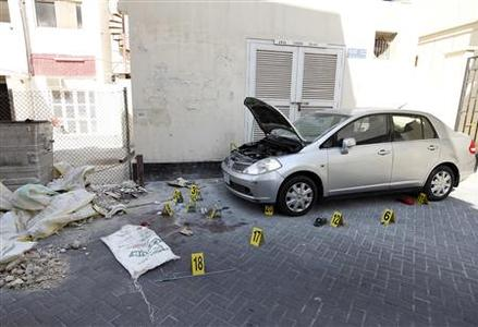 Crime scene markers are seen at a bomb site in capital of Manama, Bahrain, November 5, 2012. Five bombs exploded in the heart of the Bahraini capital Manama on Monday, killing two people, officials said, in rare attacks targeting civilians during the 21-month-old uprising against the kingdom's U.S.-backed rulers. REUTERS/Hamad I Mohammed