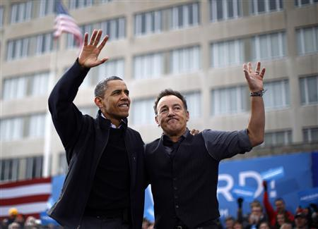 U.S. President Barack Obama is pictured with singer Bruce Springsteen (R) during an election campaign rally in Madison, Wisconsin, November 5, 2012. REUTERS/Jason Reed