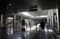 A man stands at the entrance of a closed metro station during a 24-hour strike against the government's austerity measures, halting services on the metro, railway and city trains in Athens November 5, 2012. Greece's government will present a new austerity package to parliament on Monday, facing a week of strikes and protests over proposals which must win deputies' approval if the country is to secure more aid and stave off bankruptcy. REUTERS/John Kolesidis (GREECE - Tags: POLITICS BUSINESS EMPLOYMENT TRANSPORT) GREECE OUT. NO COMMERCIAL OR EDITORIAL SALES IN GREECE