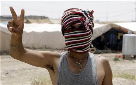 A Syrian refugee flashes the victory sign at a refugee camp near Zakho, an Iraqi border town with Syria, June 23, 2012. REUTERS/Azad Lashkari