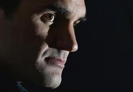 Roger Federer of Switzerland speaks at a news conference ahead of the ATP tennis finals at the O2 Arena in London November 4, 2012. REUTERS/Toby Melville