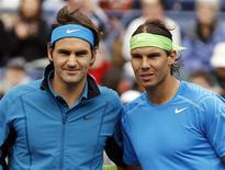 Roger Federer (L) of Switzerland and Rafael Nadal (R) of Spain pose together before their men's semi-final match at the Indian Wells ATP tennis tournament in Indian Wells, California, March 17, 2012. REUTERS/Danny Moloshok