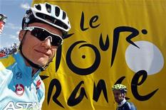 Astana Pro Team rider Alexandre Vinokourov of Kazakhstan arrives at the sign-in podium before the start of the seventh stage of the 99th Tour de France cycling race between Tomblaine and La Planche des Belles Filles July 7, 2012. REUTERS/Bogdan Cristel