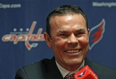 Adam Oates, the new head coach of the NHL hockey team the Washington Capitals, smiles during a news conference in Washington June 27, 2012. REUTERS/Kevin Lamarque
