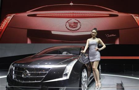 A model stands next to a Cadillac ELR at Auto China 2012 in Beijing April 24, 2012. General Motors expects sales of its Cadillac models in China to match U.S. sales levels by 2015 or 2016, the company's chief executive said on Monday. REUTERS/Jason Lee