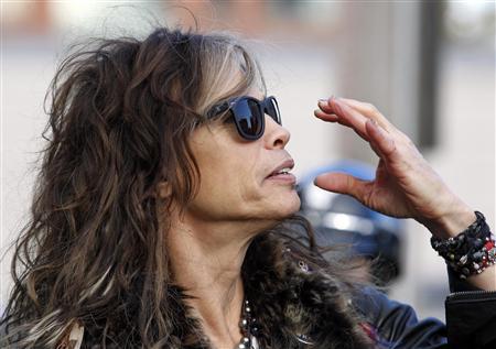 Aerosmith's Steven Tyler adjusts his sunglasses in Boston, Massachusetts November 5, 2012. REUTERS/Jessica Rinaldi