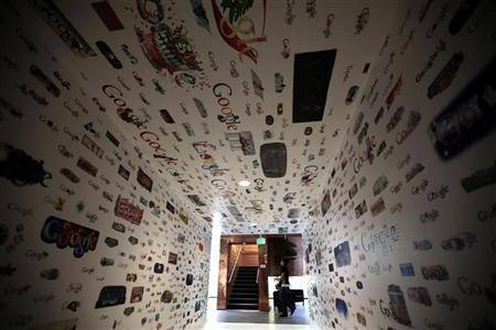 A woman walks past a tunnel of Google homepage logos at the Google campus near Venice Beach, in Los Angeles, California January 13, 2012. REUTERS/Lucy Nicholson