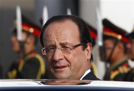 France's President Francois Hollande arrives at Vientiane airport November 5, 2012. REUTERS/Sukree Sukplang