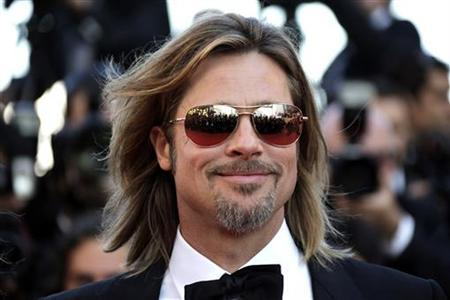 Cast member Brad Pitt poses on the red carpet ahead of the screening of the film ''Killing Them Softly'', in competition at the 65th Cannes Film Festival, May 22, 2012. REUTERS/Eric Gaillard/Files