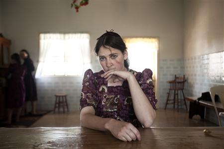 This undated handout is a photograph by Spanish photographer Jordi Ruiz Cirera, of 26-year-old Bolivian Margarita Teichroeb, which has won the Taylor Wessing Photographic Portrait Prize in London. Ruiz Cirera, 28, won the prize for his picture of Teichroeb, whose religious conservatism made her uncomfortable before the camera. REUTERS/Jordi Ruiz Cirera/Handout