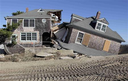 A view of the remains of a beach front home, torn in half by the force of the water in the aftermath of Hurricane Sandy, at Bay Head, New Jersey November 4, 2012. REUTERS/Tom Mihalek