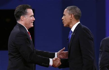 U.S. President Barack Obama (R) and Republican Presidential nominee Mitt Romney shake hands at the conclusion of the final presidential debate at Lynn University in Boca Raton, Florida October 22, 2012. REUTERS/Kevin Lamarque