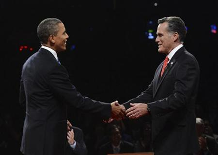 Republican presidential nominee Mitt Romney shakes hands with President Barack Obama at the start of the first 2012 U.S. presidential debate in Denver October 3, 2012. REUTERS/Michael Reynolds/Pool