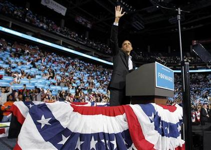U.S. President Barack Obama waves as he arrives at an election campaign rally in Columbus, Ohio, November 5, 2012, on the eve of the U.S. presidential elections. REUTERS/Jason Reed