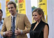 "Cast member Kristen Bell poses, as her fiance and co-star Dax Shepard watches, at the premiere of ""Hit and Run"" at Regal Cinemas in Los Angeles, California August 14, 2012. REUTERS/Mario Anzuoni"