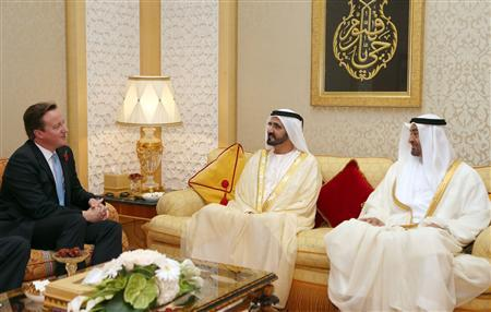 Britain's Prime Minister David Cameron (L) meets with United Arab Emirates' Vice President and Prime Minister and Ruler of Dubai Sheikh Mohammed bin Rashid al-Maktoum and Abu Dhabi Crown Prince Sheikh Mohammed bin Zayed al-Nahayan (R) during his visit to Dubai November 5, 2012. REUTERS/WAM/Handout