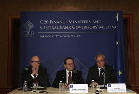 Victor Constancio (2nd R) Vice-President of the European Central Bank and Olli Rehn (R) European Economic and Monetary Affairs Commissioner attend a news conference on the second day of the G20 at a hotel in Mexico City November 5, 2012. REUTERS/Henry Romero