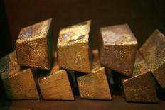 Gold bars are displayed at South Africa's Rand Refinery in Germiston May 30, 2006. REUTERS/Siphiwe Sibeko