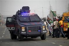 A police armoured vehicle is parked as protesters march through Ikorodu road during a protest against a fuel subsidy removal in Lagos January 9, 2012. REUTERS/Akintunde Akinleye
