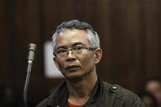 Thai national Chumlong Lemtongthai is seen during a court appearance on charges of rhino poaching at the Kempton Park Magistrate's Court November 8 2011. REUTERS/Siphiwe Sibeko