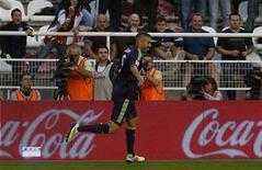 Real Madrid's Karim Benzema celebrates his goal against Rayo Vallecano during their Spanish First Division soccer match at Teresa Rivero stadium in Madrid September 24, 2012. REUTERS/Susana Vera