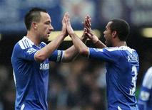 Chelsea's John Terry (L) celebrates his goal against Queens Park Rangers with Ashley Cole during their English Premier League soccer match at Stamford Bridge in London April 29, 2012. REUTERS/Eddie Keogh