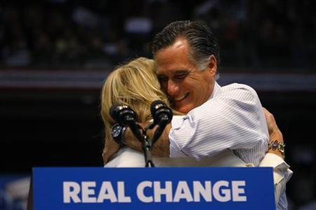 Republican presidential nominee Mitt Romney hugs his wife Ann at the final rally of the campaign in Manchester, New Hampshire November 6, 2012. REUTERS/Brian Snyder