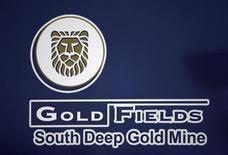 A Gold Fields Mine company logo is seen outside the South Deep Gold mine, near Johannesburg, June 4, 2010. REUTERS/Siphiwe Sibeko
