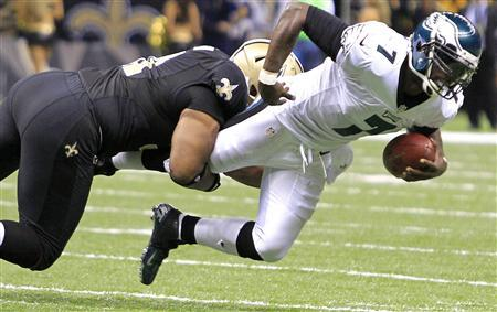 Philadelphia Eagles quarterback Michael Vick (7) is sacked by New Orleans Saints defensive end Will Smith (91) during the second half of their NFL football game in New Orleans, Louisiana, November 5, 2012. REUTERS/Sean Gardner