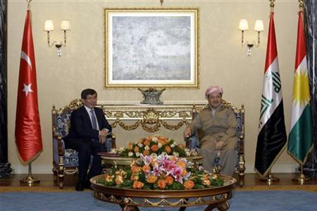 Kurdistan Region President Masoud Barzani (R) meets with Turkish Foreign Minister Ahmet Davutoglu in Arbil, about 350 km (220 miles) north of Baghdad, August 1, 2012. REUTERS/Azad Lashkari