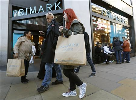 A shopper carries a Primark shopping bag on Oxford Street in central London November 5, 2012. Primark-owner Associated British Foods will post its year-end results on Tuesday. REUTERS/Olivia Harris
