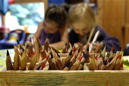 Coloured pencils are pictured in a wooden box at a nursery school in Eichenau near Munich June 18, 2012. REUTERS/Michaela Rehle (GERMANY - Tags: EDUCATION SOCIETY)