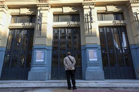 A man stands in front of a closed tram station in Athens November 6, 2012. Thousands of Greek workers began a 48-hour strike on Tuesday to protest a new round of austerity cuts that unions say will devastate the poor and drive a failing economy to collapse. REUTERS/Costas Baltas (GREECE - Tags: BUSINESS EMPLOYMENT)