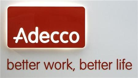 An Adecco logo is pictured at the company's headquarters in Glattbrugg near Zurich December 15, 2008. REUTERS/Christian Hartmann (SWITZERLAND)