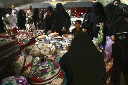 File photo of veiled women browsing at the Riyadh Heritage and Culture Festival in Riyadh late April 24, 2009. REUTERS/Fahad Shadeed