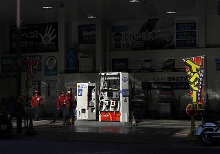 Workers stand to wait for customers at a gas station in Tokyo March 15, 2012 REUTERS/Toru Hanai