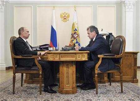 Russian President Vladimir Putin (L) meets with former Governor of Moscow Region and newly appointed Defence Minister Sergei Shoigu at the Novo-Ogaryovo state residence outside Moscow, November 6, 2012. Putin dismissed Defence Minister Anatoly Serdyukov on Tuesday after the ministry was drawn in to an investigation into allegations of fraudulent sales of military assets. Putin was shown on television informing Sergei Shoigu, a former emergencies minister, that he wanted him to replace Serdyukov. REUTERS/Aleksey Nikolskyi/RIA Novosti/Pool (RUSSIA - Tags: POLITICS MILITARY) THIS IMAGE HAS BEEN SUPPLIED BY A THIRD PARTY. IT IS DISTRIBUTED, EXACTLY AS RECEIVED BY REUTERS, AS A SERVICE TO CLIENTS