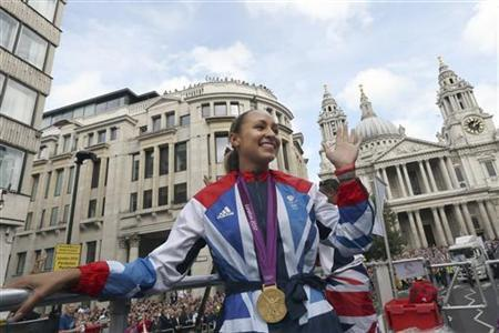 British Olympic heptathlon gold medalist Jessica Ennis waves to the crowd during the London 2012 Victory Parade for Team GB and Paralympic GB athletes in London September 10, 2012. REUTERS/Dan Kitwood/Pool