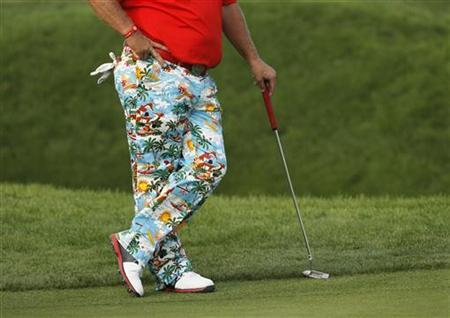 John Daly of the U.S. stands on the green during the BMW Masters 2012 golf tournament at Lake Malaren Golf Club in Shanghai, October 26, 2012. REUTERS/Aly Song