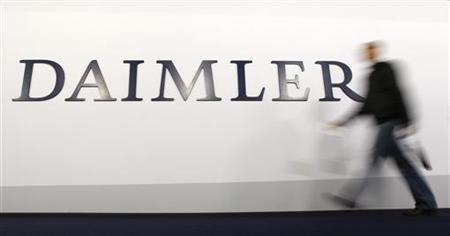 A shareholder arrives to a Daimler AG annual shareholder meeting in Berlin, April 4, 2012. REUTERS/Fabrizio Bensch (GERMANY - Tags: BUSINESS TRANSPORT)