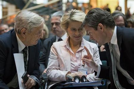 German Labour Minister Ursula von der Leyen (C) talks with Soros Fund Management Chairman George Soros (L) and investor Nicolas Berggruen at the Nicolas Berggruen Conference in Berlin, October 30, 2012. REUTERS/Thomas Peter (GERMANY - Tags: POLITICS BUSINESS)