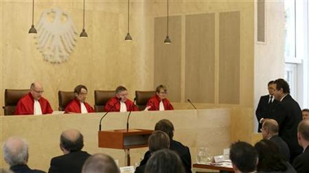 Minister of the Interior Hans-Peter Friedrich (R) appeals to the judges of the German Federal Constititional Court prior to the hearing concerning a nationwide anti-terror file database (Antiterrordatei) in Karlsruhe November 6, 2012. REUTERS/Ralf Stockhoff (GERMANY - Tags: POLITICS CRIME LAW)