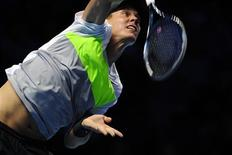 Tomas Berdych of Czech Republic serves to Andy Murray of Britain during their men's singles tennis match at the ATP World Tour Finals in the O2 Arena in London November 5, 2012. REUTERS/Kieran Doherty