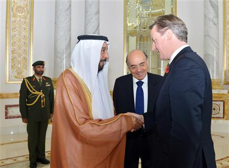 Britain's Prime Minister David Cameron (R) shakes hands with President of the United Arab Emirates Sheikh Khalifa bin Zayed bin Sultan Al Nahyan during his arrival to Al Ain, November 6, 2012. REUTERS/WAM/Handout