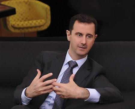 A handout photo distributed by Syrian News Agency (SANA) on July 3, 2012, shows Syria's President Bashar al-Assad during an interview with a Turkish newspaper in Damascus. REUTERS/SANA/Handout/Files