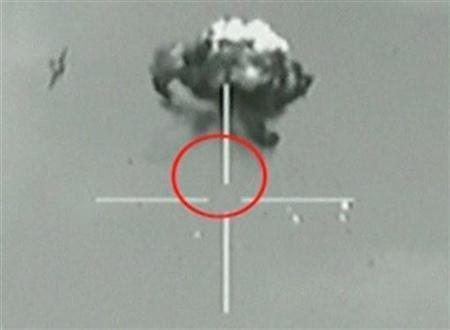 A still image taken from Israeli Defence Forces (IDF) video footage shows what they say is a small unidentified aircraft shot down in a mid-air interception after it crossed into southern Israel October 6, 2012. REUTERS/IDF via Reuters TV
